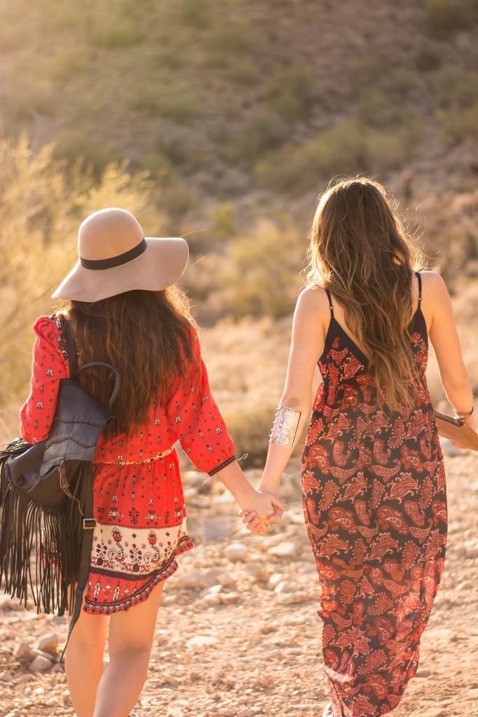 Holding hands, walking away